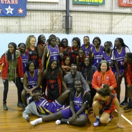 Girls team with one of their oponents